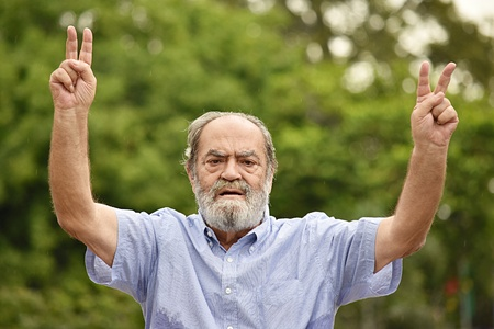 Man And Peace Sign Stock Photo