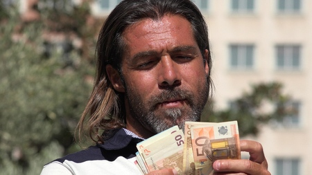 Caucasian Male Counting Money Stock Photo