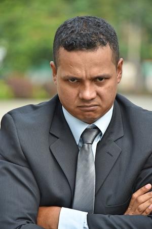 Stubborn Hispanic Businessman Wearing Business Suit