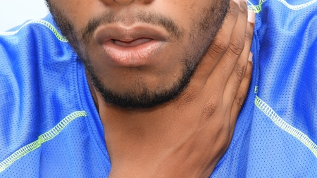 Unshaven Black Male With Sore Throat