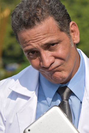 Confused Colombian Male Doctor Stock Photo