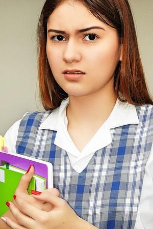 Unhappy Hispanic Girl Student Stock Photo
