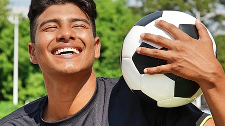Sporty Male Soccer Player Laughing