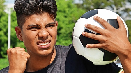 Fit Male Soccer Player And Anger