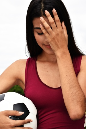 Stressful Female Soccer Player Stock Photo