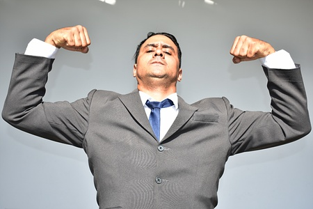 Business Man And Muscles Stock Photo