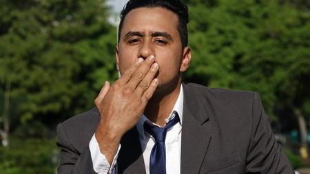 Business Man Blowing Kisses Imagens