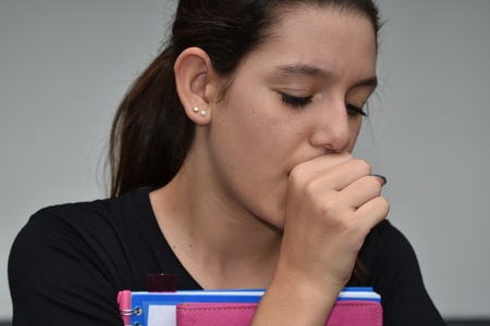 Coughing Colombian Female Student Stock Photo