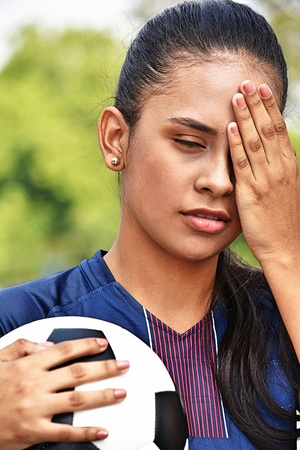 Stressed Young Female Teen Soccer Player Stock Photo
