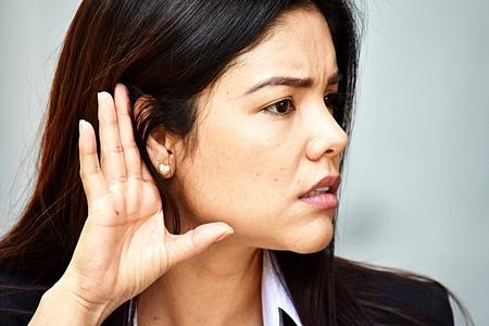Hispanic Business Woman Listening Wearing Suit