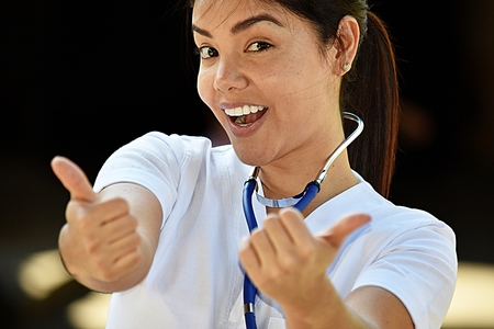 Happy Young Colombian Female Nurse Medical Professional Wearing Scrubs