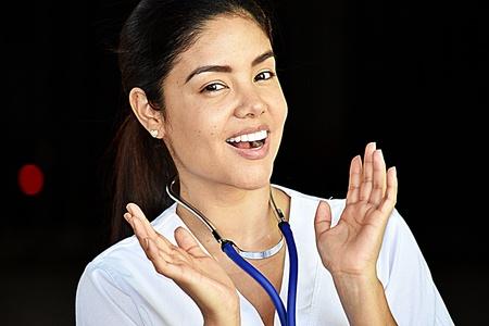 Happy Hispanic Medical Professional Wearing Scrubs Stock Photo