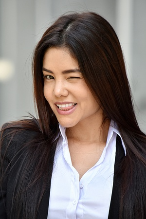 Colombian Business Woman Winking Wearing Suit Stock Photo