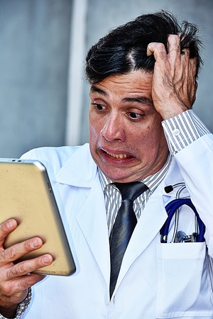 Stressful Male Medic With Tablet