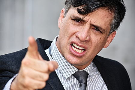 Entrepreneur And Anger Wearing Suit And Tie Stock Photo