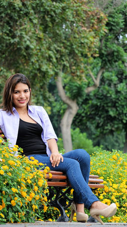 Female Outdoors Sitting On Bench