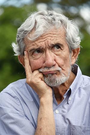 Senior Colombian Grandfather Deciding