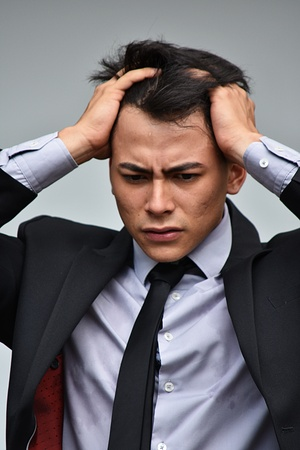 Young Businessman Under Stress Wearing Suit And Tie Stock Photo
