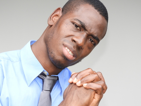 A businessman making a hopeful hand gesture Stock fotó