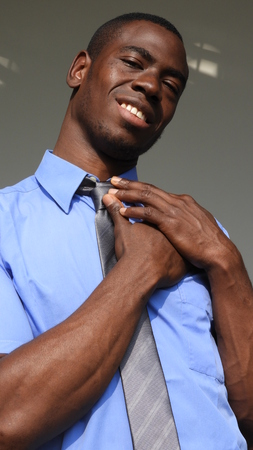 A hopeful businessman in blue shirt and tie