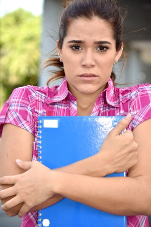 Adult Female Student With Notebooks And Fear