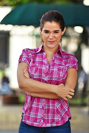 Confident Young Person Wearing Pink Shirt Stock Photo