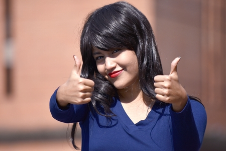 Woman With Thumbs Up Wearing A Wig