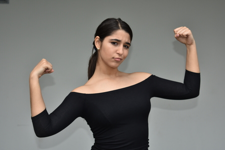 Pretty Female And Muscles Stock Photo