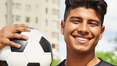 Smiling Young Hispanic Male Soccer Player