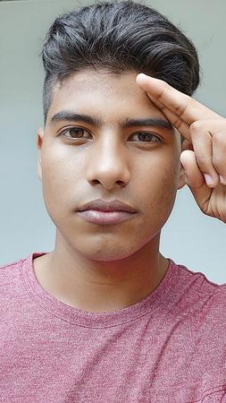 Teenage Boy Saluting Banco de Imagens
