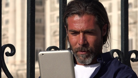 Male Using Tablet