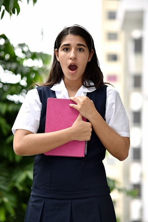 Surprised Female Student With Notebook Stock Photo