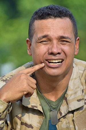 Male Soldier With Toothache
