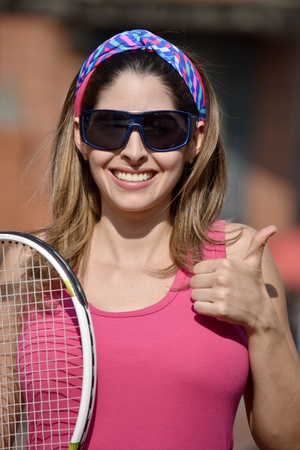 Colombian Girl Tennis Player And Happiness Wearing Sunglasses With Tennis Racket
