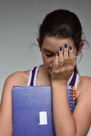 Unhappy Hispanic Girl Student Banco de Imagens
