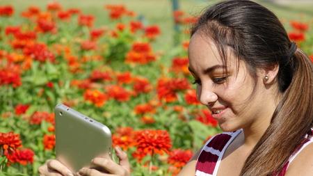 Female Teen Girl Using Tablet