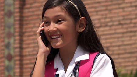 Hispanic Female Talking On Phone