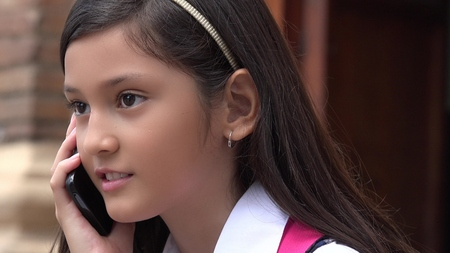 Youthful Colombian Girl Using Cell Phone