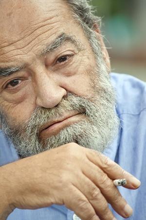 Smoking Bearded Old Male