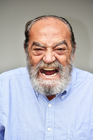 Mad Senior Colombian Male Grandpa Stock Photo