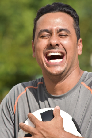 Laughing Adult Male Soccer Player