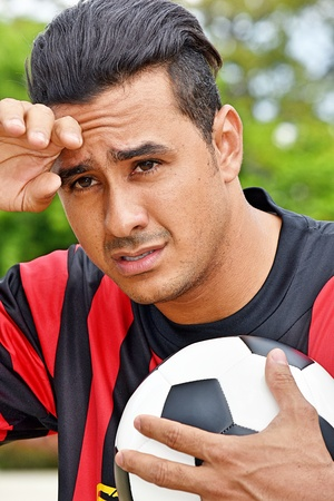 Stressed Adult Male Soccer Player