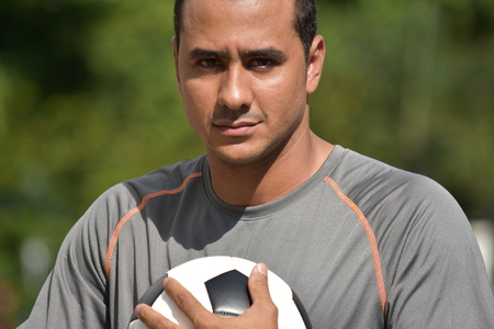 Serious Adult Male Soccer Player Stock Photo