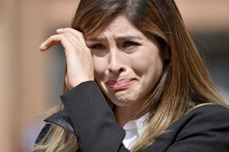 Crying Business Woman Wearing Suit Banque d'images