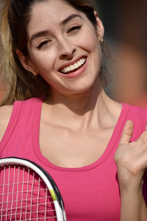 Happy Athlete Female Adult Wearing Sportswear With Tennis Racket