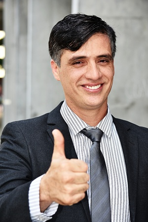 Entrepreneur With Thumbs Up Wearing Suit And Tie