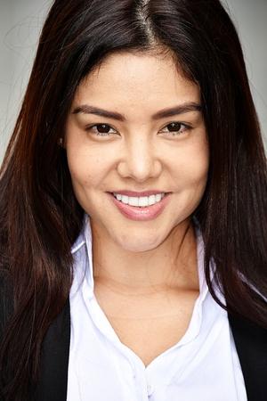 Smiling Hispanic Business Woman Wearing Suit Stock Photo