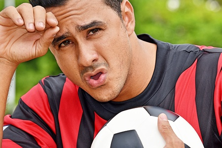 Tired Adult Male Soccer Player Stock Photo