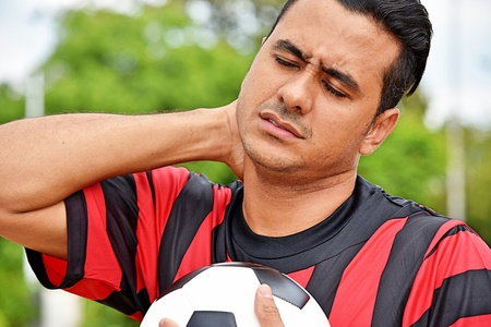 Sore Or Stressed Adult Male Soccer Player Stock Photo
