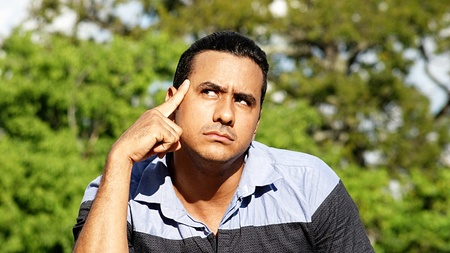 Thinking Adult Hispanic Male Stock Photo
